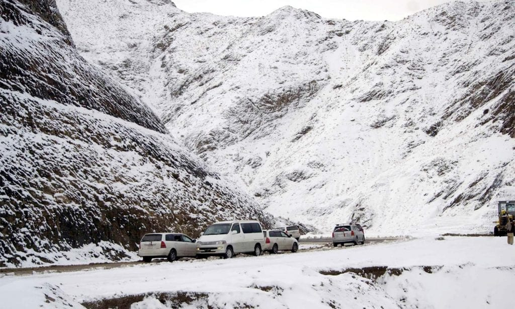 CHAMAN, PAKISTAN, DEC 09: Commuters pass through road while snow covered area after first heavy snowfall of winter season at Kozak Top in Chaman on Wednesday, December 09, 2015. (Matiullah Achakzai/PPI Images).